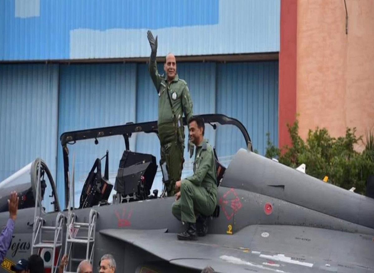 Rajnath singh flying Tejas fighter plan
